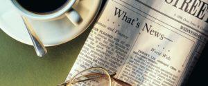 Image illustrant une café et un journal